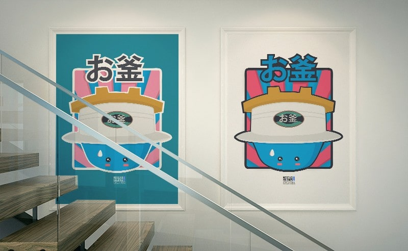 Photograph of two framed posters with the Okama illustrations.