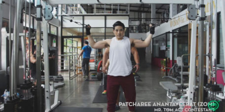 A tomboy, Patcharee Anantaveerat, weight training in the gym, showing off biceps and hairy armpit.