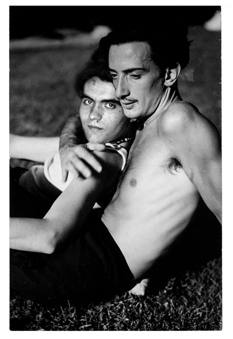 Federico García Lorca and his Ode to Walt Whitman. Lorca leaning on Dali on the beach. Black and white photography.
