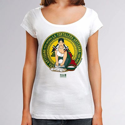 Close-up photograph of a white T-shirt worn by a girl with the Tortillera drawing, a fictional logo of a flour brand named tortillera, focused on a beautiful young woman with generous breasts.