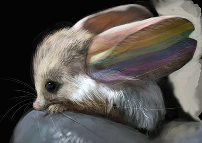 Photograph of a gerbil, Gerboise in French, with ears painted in the colors of the rainbow