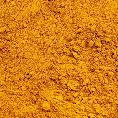 Close-up photograph of yellow soil, Terre Jaune in French.
