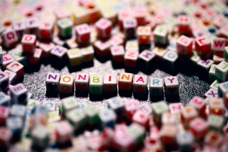 The phrase Non-Binary, made up of letter cubes illustrates Sexual Identity